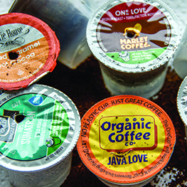 Used pierced single serve coffee k-cups with coffee grounds